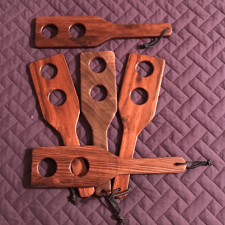 Spanking paddles made with various types of exotic woods